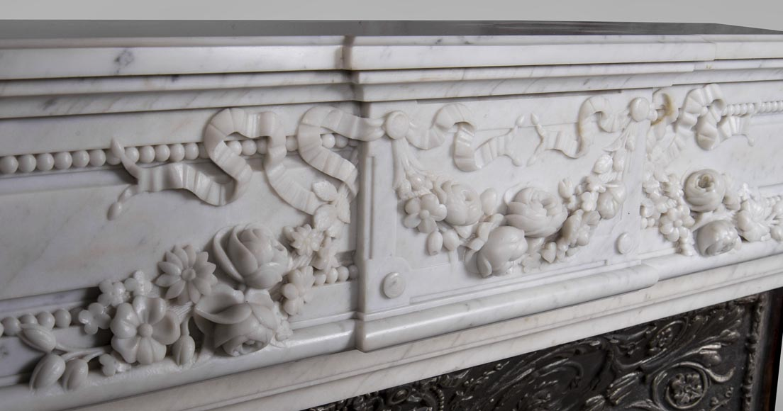 An antique Louis XVI style fireplace, made out of Carrara marble, entablature richly carved with garland of flowers-1