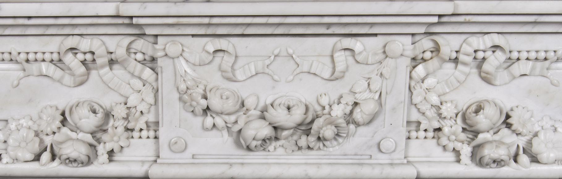 An antique Louis XVI style fireplace, made out of Carrara marble, entablature richly carved with garland of flowers-2
