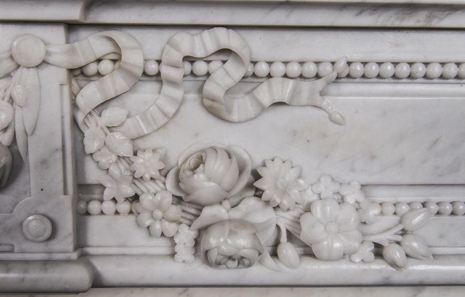 An antique Louis XVI style fireplace, made out of Carrara marble, entablature richly carved with garland of flowers-3