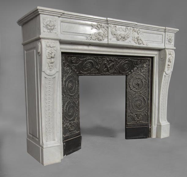 An antique Louis XVI style fireplace, made out of Carrara marble, entablature richly carved with garland of flowers-4
