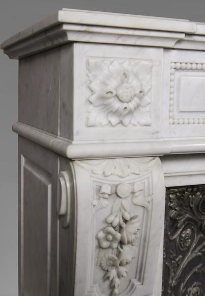 An antique Louis XVI style fireplace, made out of Carrara marble, entablature richly carved with garland of flowers-5