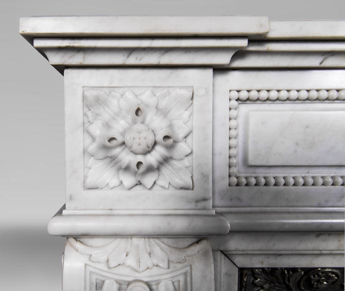 An antique Louis XVI style fireplace, made out of Carrara marble, entablature richly carved with garland of flowers-6