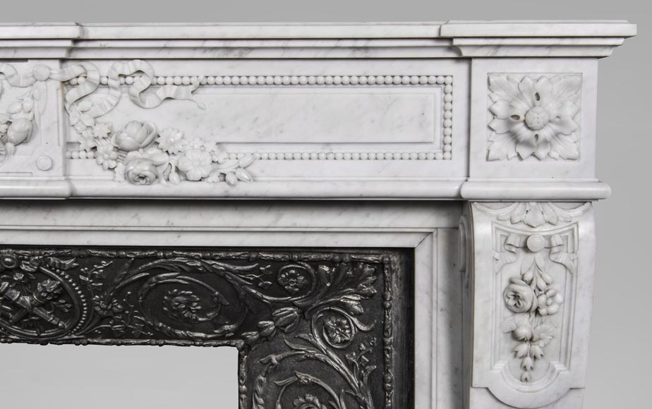 An antique Louis XVI style fireplace, made out of Carrara marble, entablature richly carved with garland of flowers-9