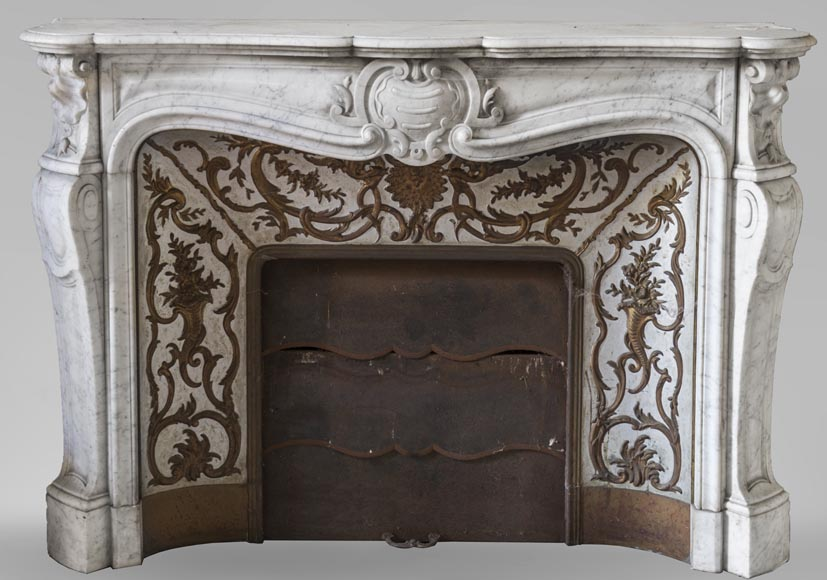 An antique Louis XV style fireplace made out of Carrara marble with its original enameled insert-0