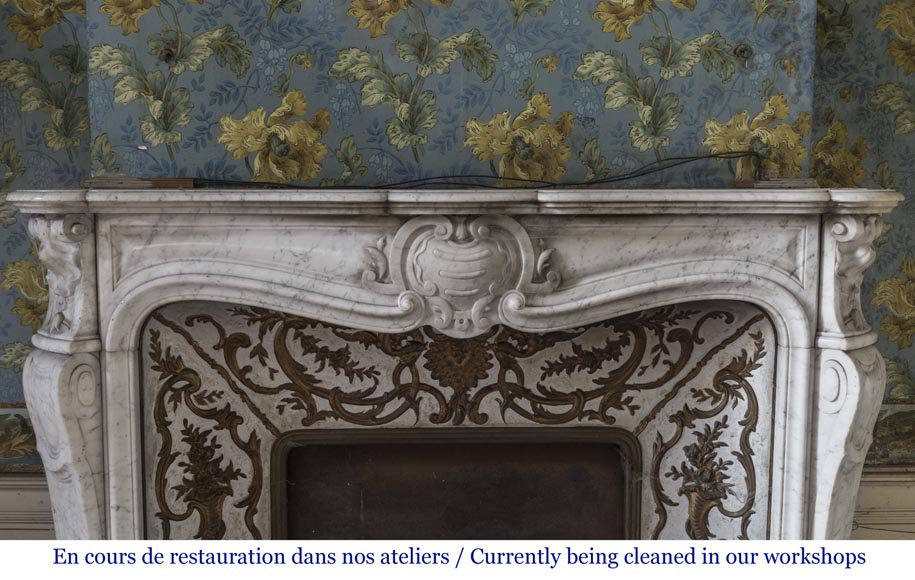 An antique Louis XV style fireplace made out of Carrara marble with its original enameled insert-1