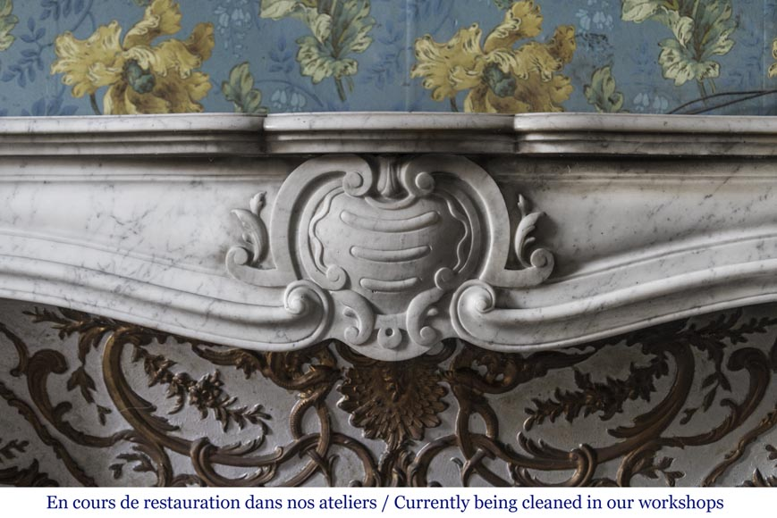 An antique Louis XV style fireplace made out of Carrara marble with its original enameled insert-2