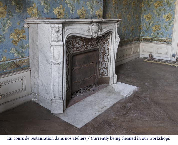 An antique Louis XV style fireplace made out of Carrara marble with its original enameled insert-3