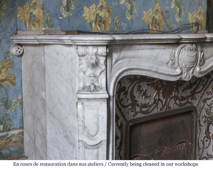 An antique Louis XV style fireplace made out of Carrara marble with its original enameled insert-4