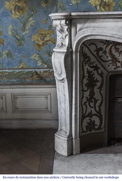 An antique Louis XV style fireplace made out of Carrara marble with its original enameled insert-6
