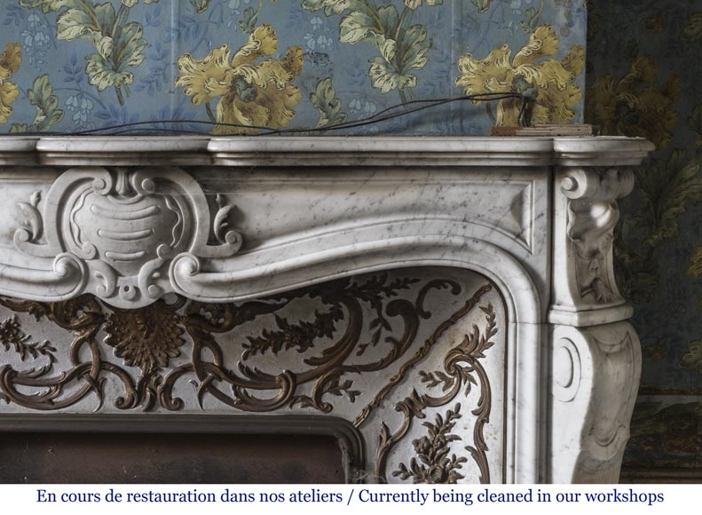 An antique Louis XV style fireplace made out of Carrara marble with its original enameled insert-7