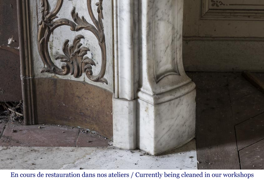 An antique Louis XV style fireplace made out of Carrara marble with its original enameled insert-8