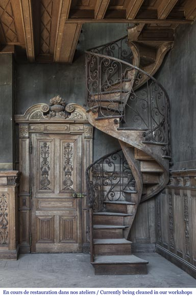 Beautiful spiral staircase with a wrought iron railing