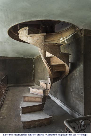 A spiral staircase made out of wood-1