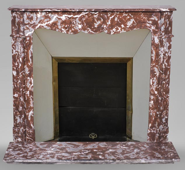 An antique Louis XV style fireplace, Pompadour model, made out of Rouge du Nord marble-0
