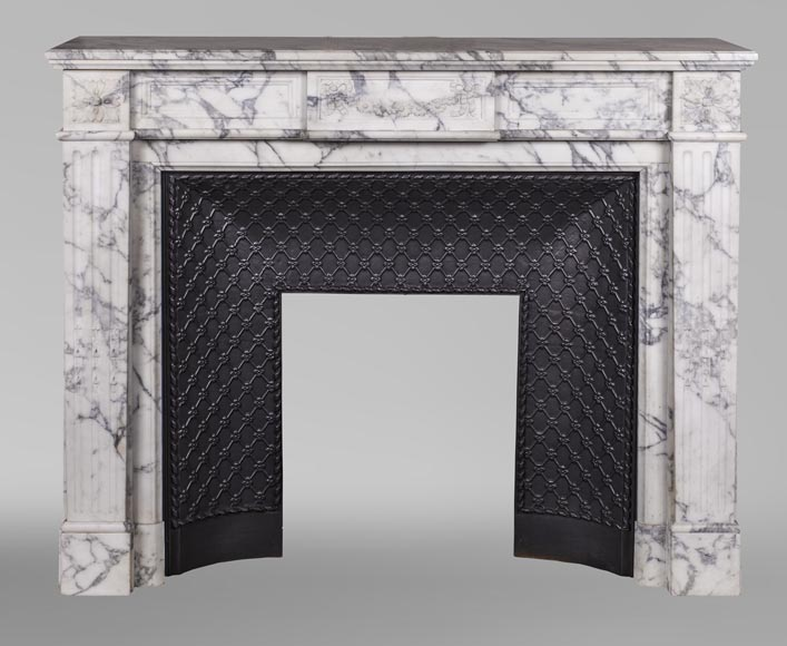 An antique Louis XVI style fireplace, with daisy garland, made out of Arabescato marble-0