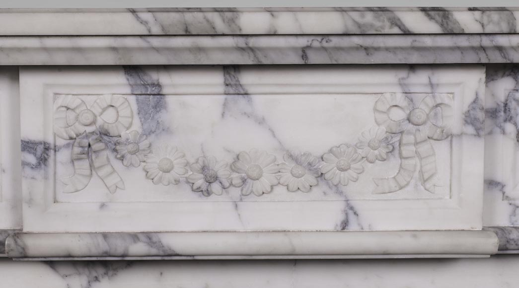 An antique Louis XVI style fireplace, with daisy garland, made out of Arabescato marble-1