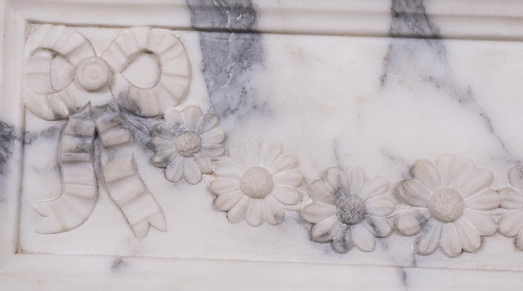 An antique Louis XVI style fireplace, with daisy garland, made out of Arabescato marble-2