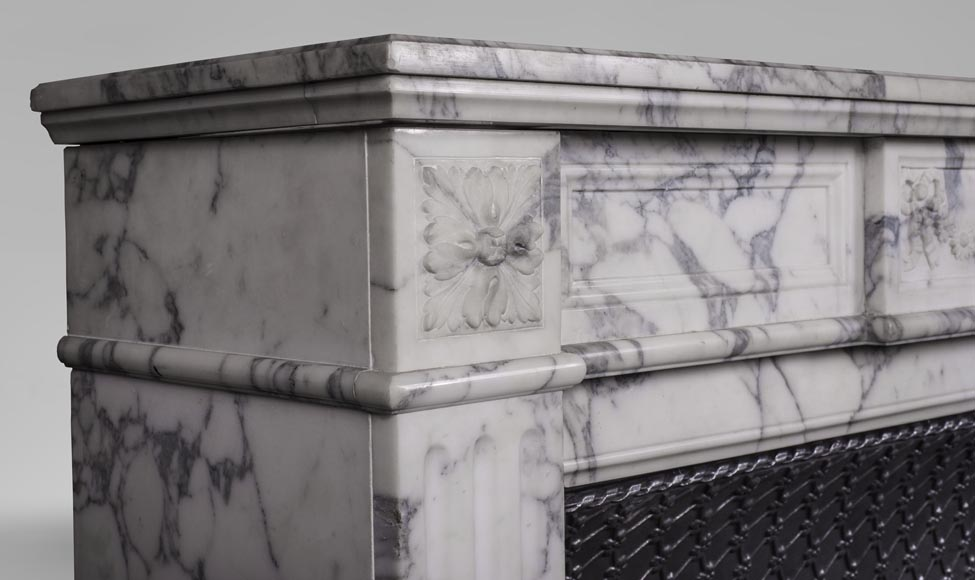 An antique Louis XVI style fireplace, with daisy garland, made out of Arabescato marble-4