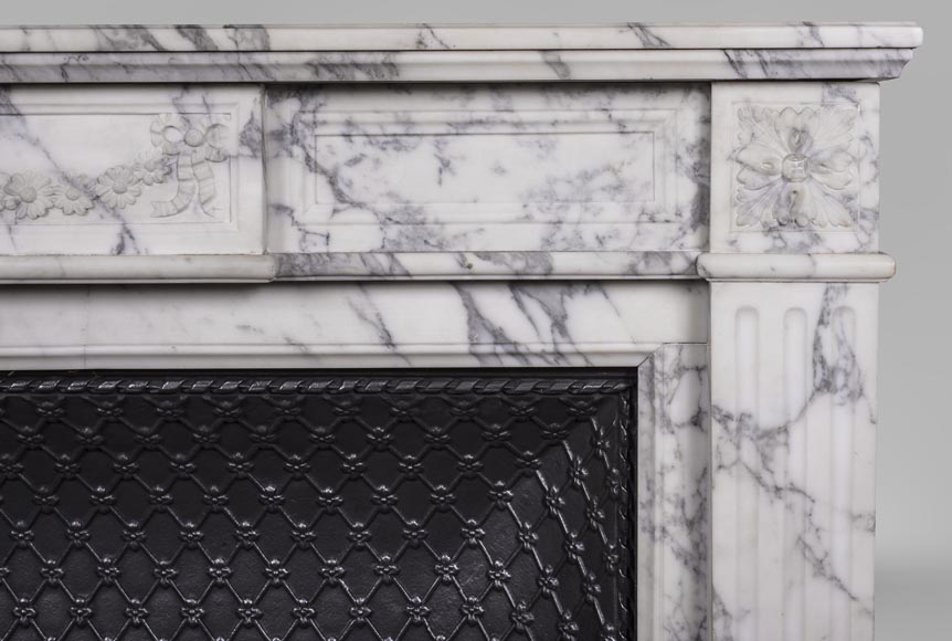 An antique Louis XVI style fireplace, with daisy garland, made out of Arabescato marble-6