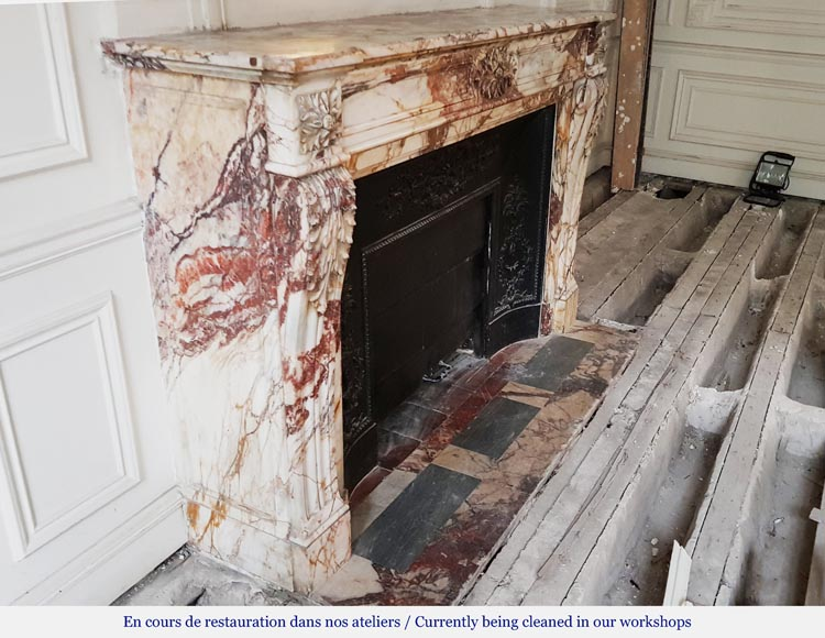 An antique Louis XVI style fireplace, made out of black marble, decorated with a floral cartouche -2