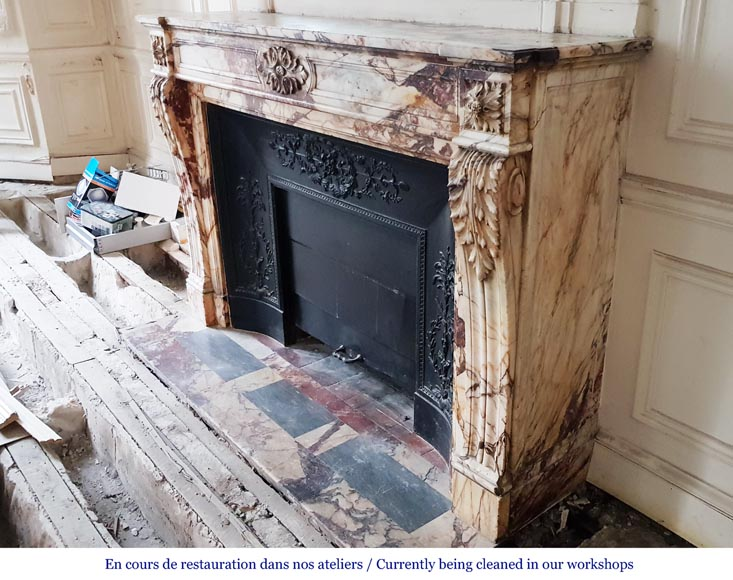 An antique Louis XVI style fireplace, made out of black marble, decorated with a floral cartouche -5