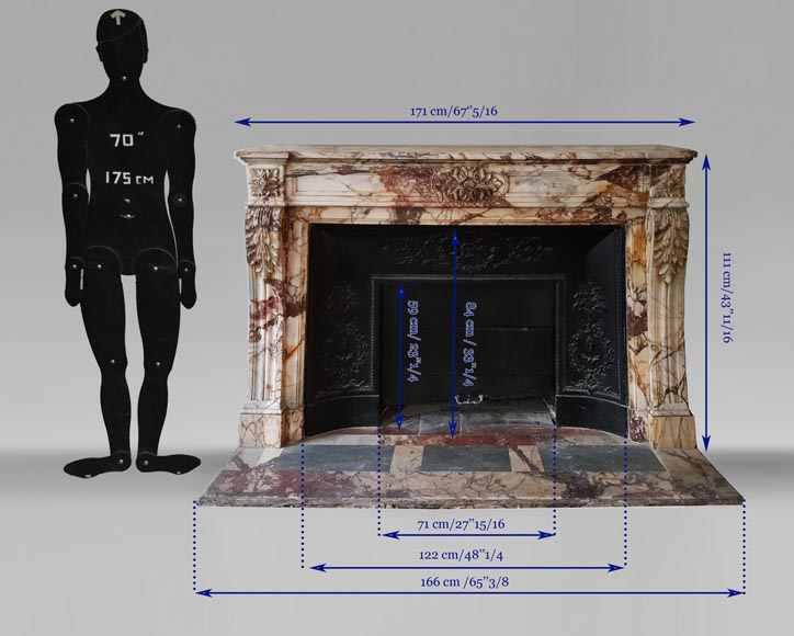 An antique Louis XVI style fireplace, made out of black marble, decorated with a floral cartouche -8