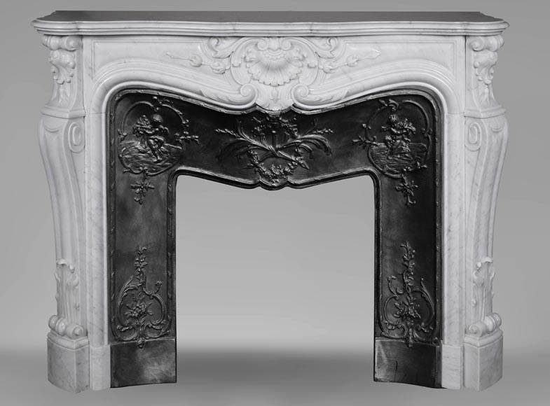 An antique Louis XV style fireplace made out of Carrara marble-0