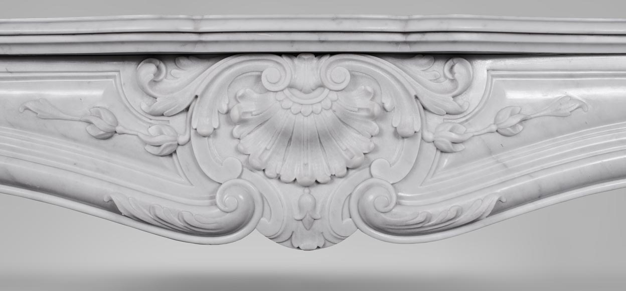 An antique Louis XV style fireplace made out of Carrara marble-1