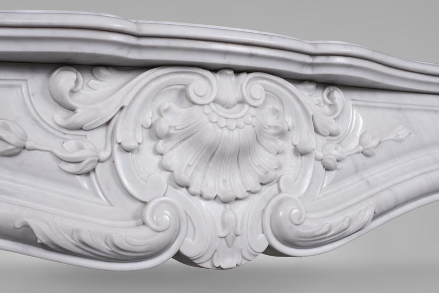 An antique Louis XV style fireplace made out of Carrara marble-2