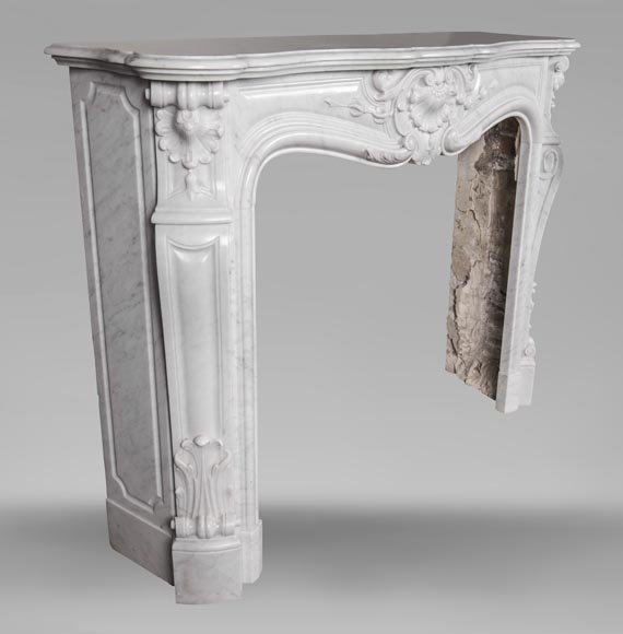 An antique Louis XV style fireplace made out of Carrara marble-4