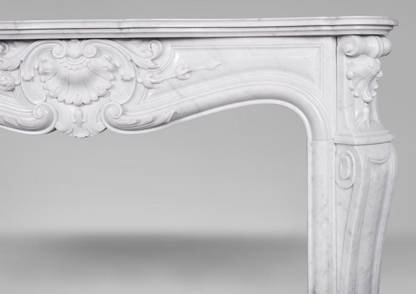 An antique Louis XV style fireplace made out of Carrara marble-8