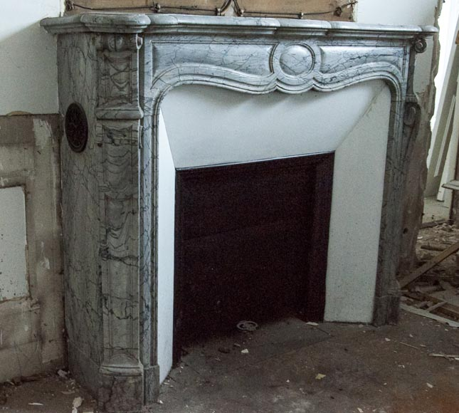 An antique Louis XV style fireplace, Pompadour model, made out of Bleu Fleuri marble-2