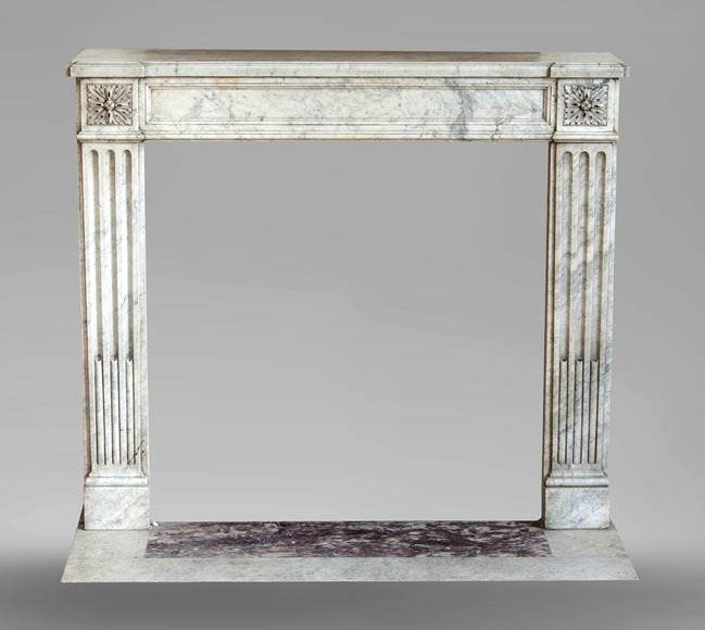 An antique Louis XVI period fireplace, made out of Carrara marble, with stop-fluted and rosettes -0