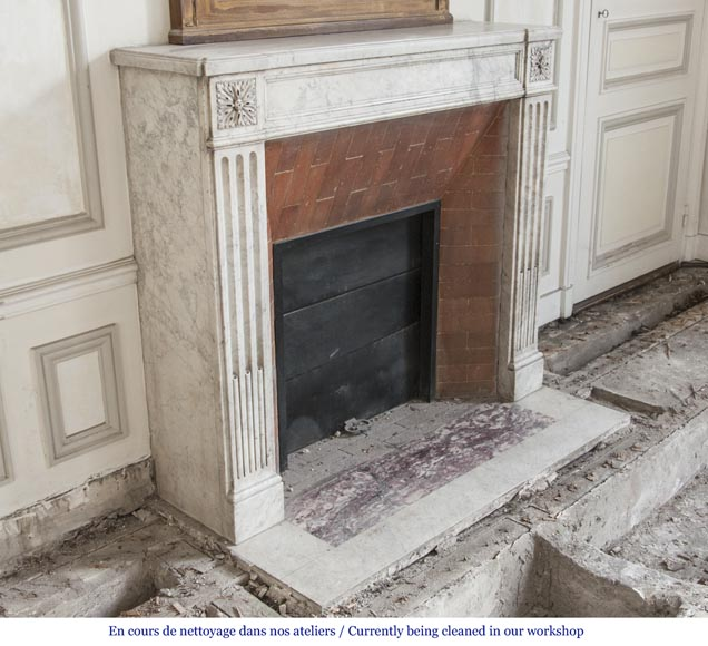 An antique Louis XVI period fireplace, made out of Carrara marble, with stop-fluted and rosettes -2