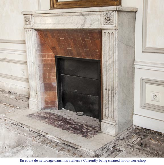 An antique Louis XVI period fireplace, made out of Carrara marble, with stop-fluted and rosettes -5