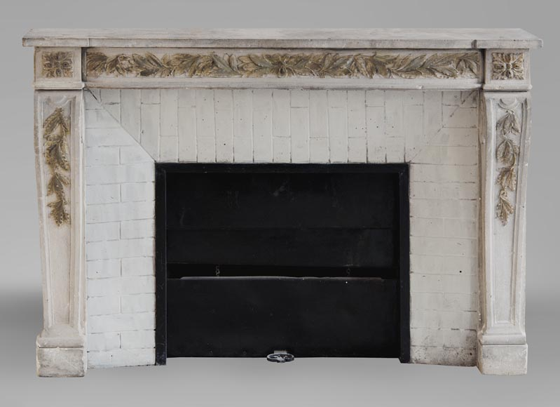 An antique Louis XVI style fireplace, made out of stone, with foliated decoration-0