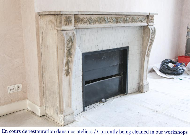 An antique Louis XVI style fireplace, made out of stone, with foliated decoration-3