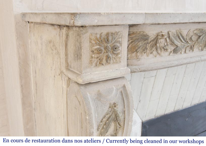 An antique Louis XVI style fireplace, made out of stone, with foliated decoration-4