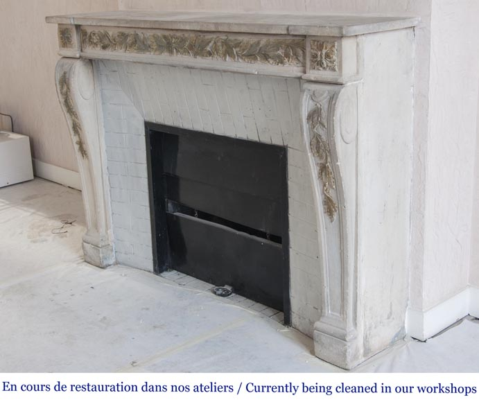 An antique Louis XVI style fireplace, made out of stone, with foliated decoration-6