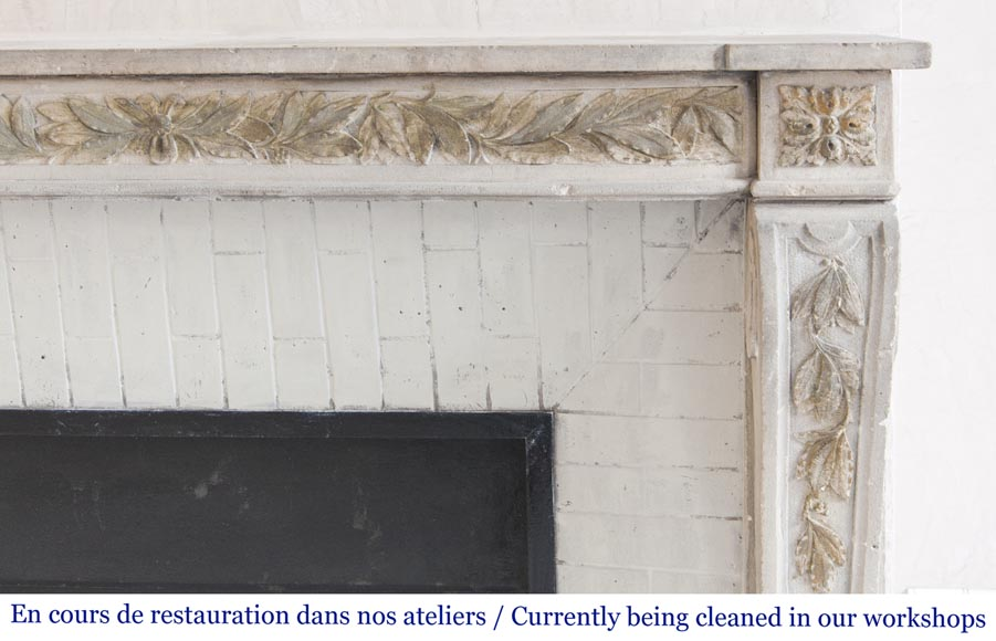 An antique Louis XVI style fireplace, made out of stone, with foliated decoration-7