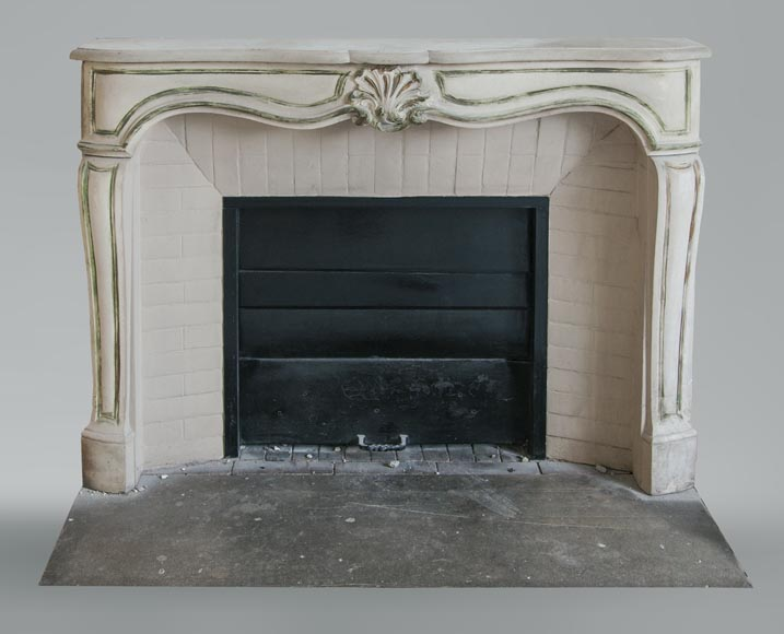 An antique Louis XV style fireplace, made out of stone-0