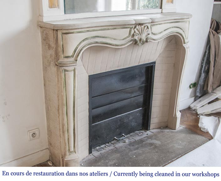 An antique Louis XV style fireplace, made out of stone-2