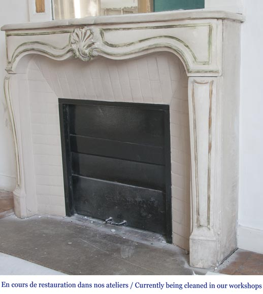 An antique Louis XV style fireplace, made out of stone-5