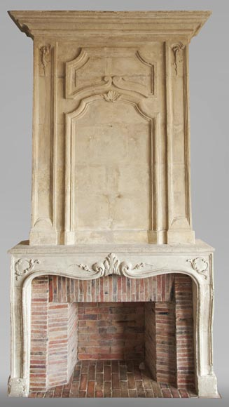 An antique Louis XV period fireplace with its trumeau, made out of stone-0