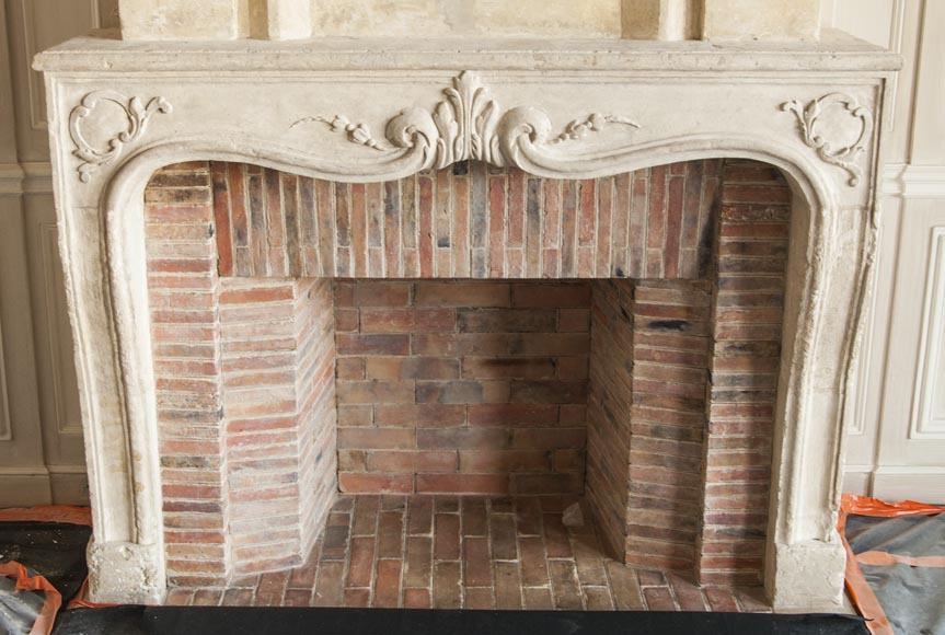 An antique Louis XV period fireplace with its trumeau, made out of stone-1