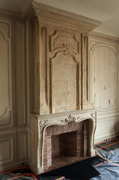 An antique Louis XV period fireplace with its trumeau, made out of stone-3