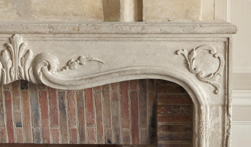 An antique Louis XV period fireplace with its trumeau, made out of stone-11