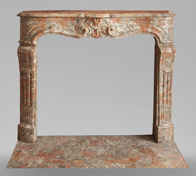 An antique Regence style fireplace made out of Incarnat Turquin marble-0