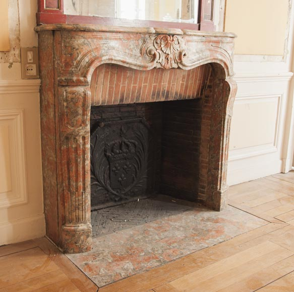 An antique Regence style fireplace made out of Incarnat Turquin marble-2