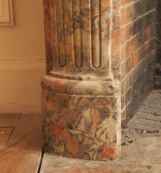 An antique Regence style fireplace made out of Incarnat Turquin marble-4